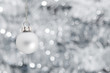 canvas print picture - Christmas ball ornament over silver garland background