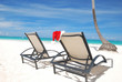 Santa's hat and chaise lounge on the beach