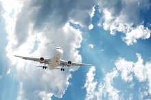 Airplane Is Flying Against Blue Sky