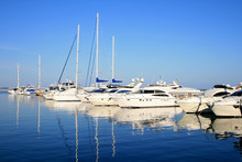 Parking Of Yachts Against The Azure Sky Is Reflected In Water
