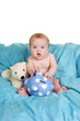 canvas print picture - Up Close of cute baby holding a biggy bank