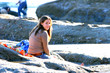 canvas print picture - Pretty Teen sitting on a rock at the beach