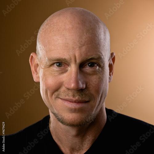 Obraz na plátně Close up studio shot of bald man with goatee and mustache
