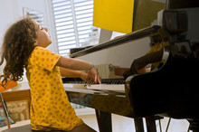 Little Girl Playing The Grand ...