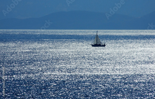 Staande foto Zeilen a boat sailing near Crete shoreline