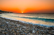 Sunset at Mediterranean beach. Village at Samos Island, Greece.