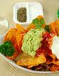 Delicious vegetarian nachos with guacamole and sour cream.