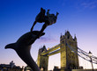 canvas print picture - Girl and Dolphin and the London Tower Bridge at night