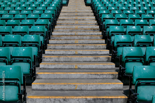 Poster Stadion Numbered steps in a sports stadium in between the seating.