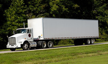 A 18-wheel Truck On A Highway,