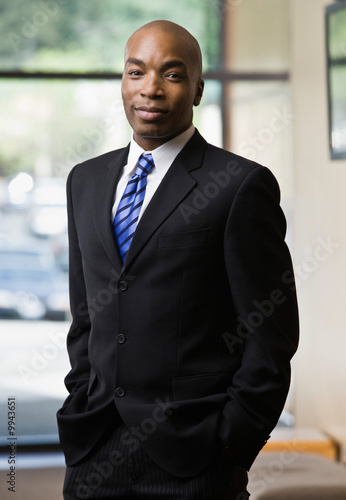 Fotografie, Obraz  Confident African businessman posing in full suit