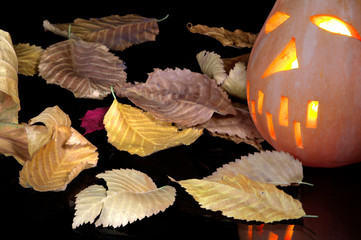 Autumn yellow leaves and pumpkin in style halloween
