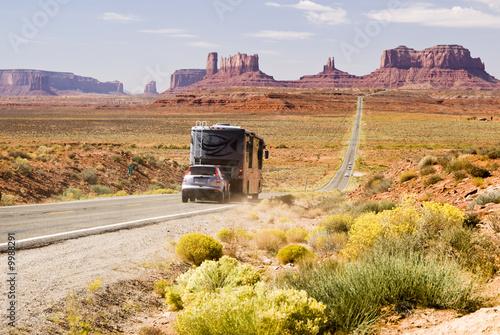 Fotografija Recreational vehicle driving through Monument Valley