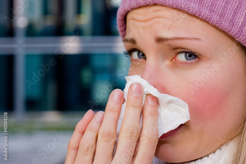 young female having a cold