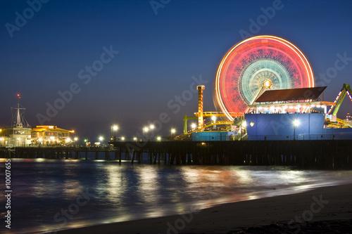 Fotografie, Obraz Santa Monica Ferris Wheel on the boardwalk at night.