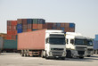 Trucks and freight containers in a logistic center