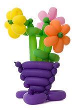 A Vase With Flowers Made Of Twisted Balloons