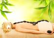Leinwandbild Motiv Massage with volcanic hot stones
