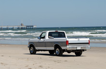 Pickup Truck Driving On The Beach, Southern Texas, USA