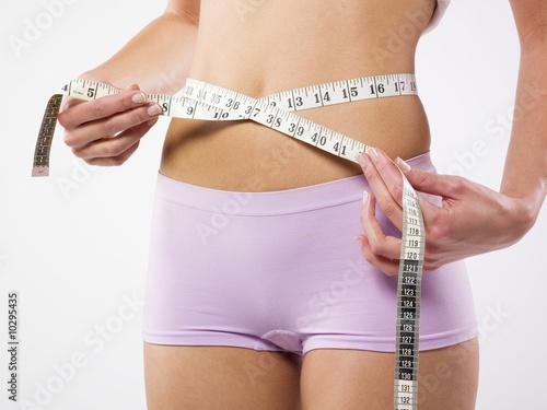 Fotografia  Woman's belt and tape measure