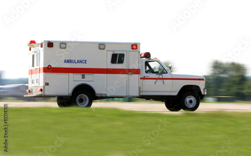 Deurstickers Oude auto s Emergency ambulance driving very fast