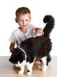 Leinwandbild Motiv Kid pats a cat