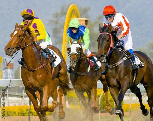 Fototapeta Jockeys on the finish line of a horserace.