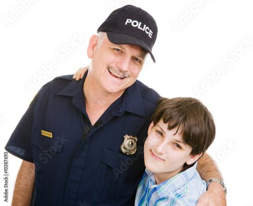 Fényképezés  Friendly police officer and an adolescent boy.  Isolated