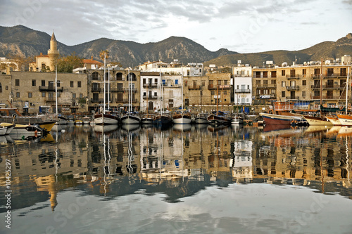 girne harbor with boats and houses and reflection
