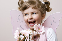 Happy Fairy With Gerber Bouquet