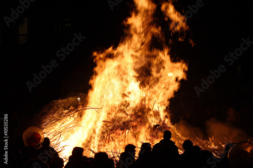 Fotografie, Obraz  People are standing front of huge fire