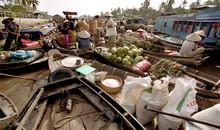 Sellers In A Floating Market. Mekong Delta, Vietnam.