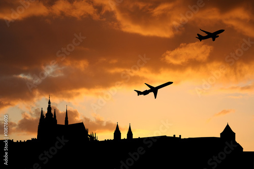 Fotografering  planes departing Prague at sunset