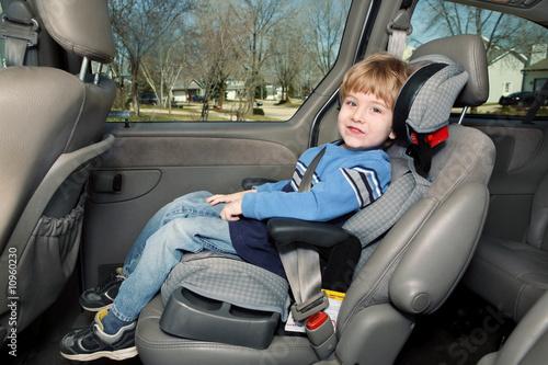 Fotografie, Obraz  Preschool age boy in a booster seat