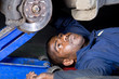 mechanic working a car
