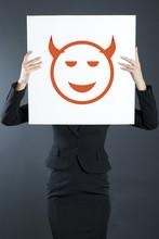 Business Woman Holding A Devil...
