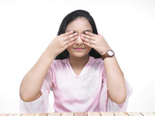 Asian Teenage Girl Covering Her Face With Her Palms
