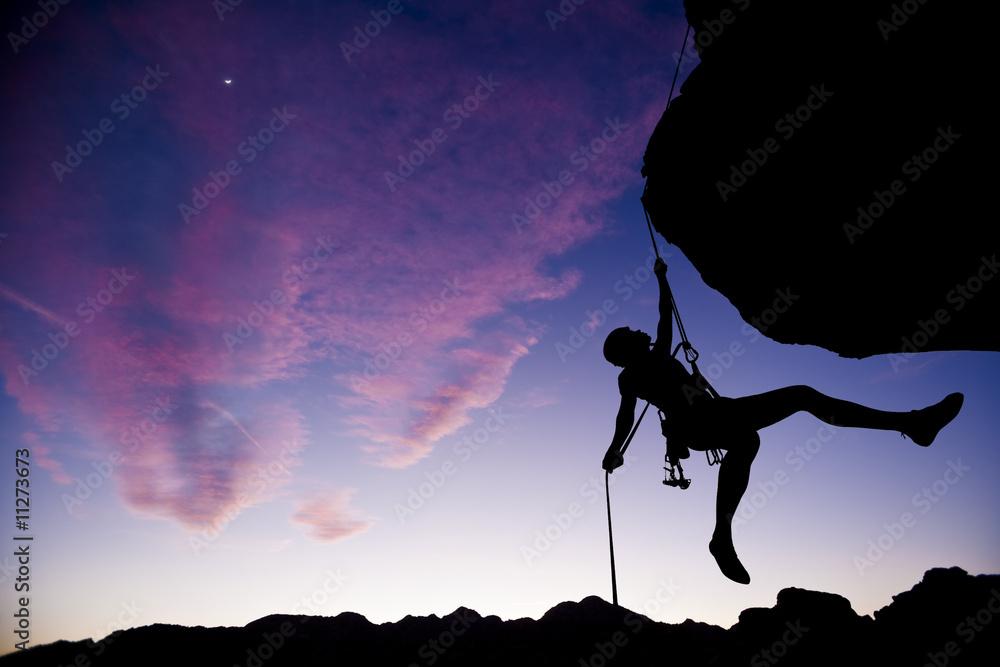 Fototapeta Climber rappelling.