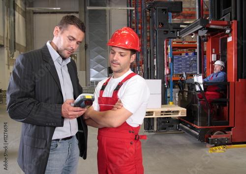 Fotografie, Obraz  boss talking to worker in uniform in factory