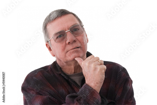 Valokuva  Portrait of senior man lost in thought, isolated on white.