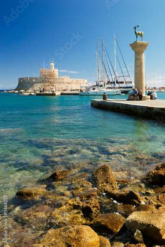Yachts and old lighthouse in the harbor of Rhodes