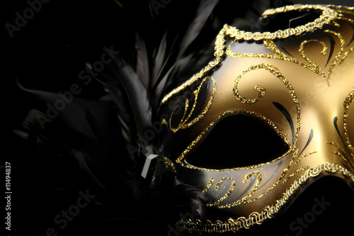 Tuinposter Carnaval ornate carnival mask over black silk background