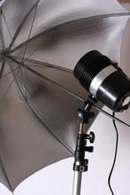 Studio Strobe Flash And Silver Umbrella