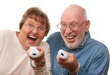 Active Senior Couple Play Vide...