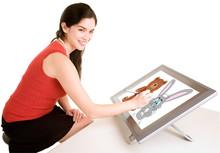 Woman Drawing On A Digital Tab...