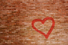 A Battered Brick Wall With A Sprayed Red Heart In Spotlight