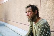 Sad Homeless Man On City Street