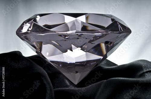 Fényképezés  Brilliant Diamond on Black Satin
