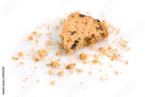 Tuinposter Koekjes Last bite of a chocolate chip cookie with crumbs