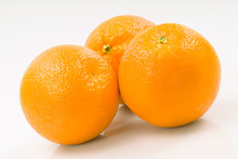 Three Oranges Grouped Together Isolated On White